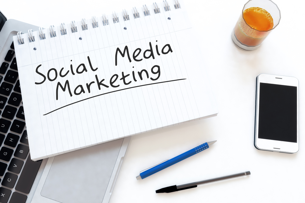 Social Media Marketing - handwritten text in a notebook on a desk - 3d render illustration.
